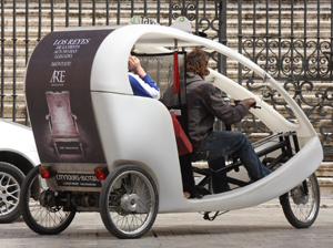 Semi-enclosed passenger tricycle